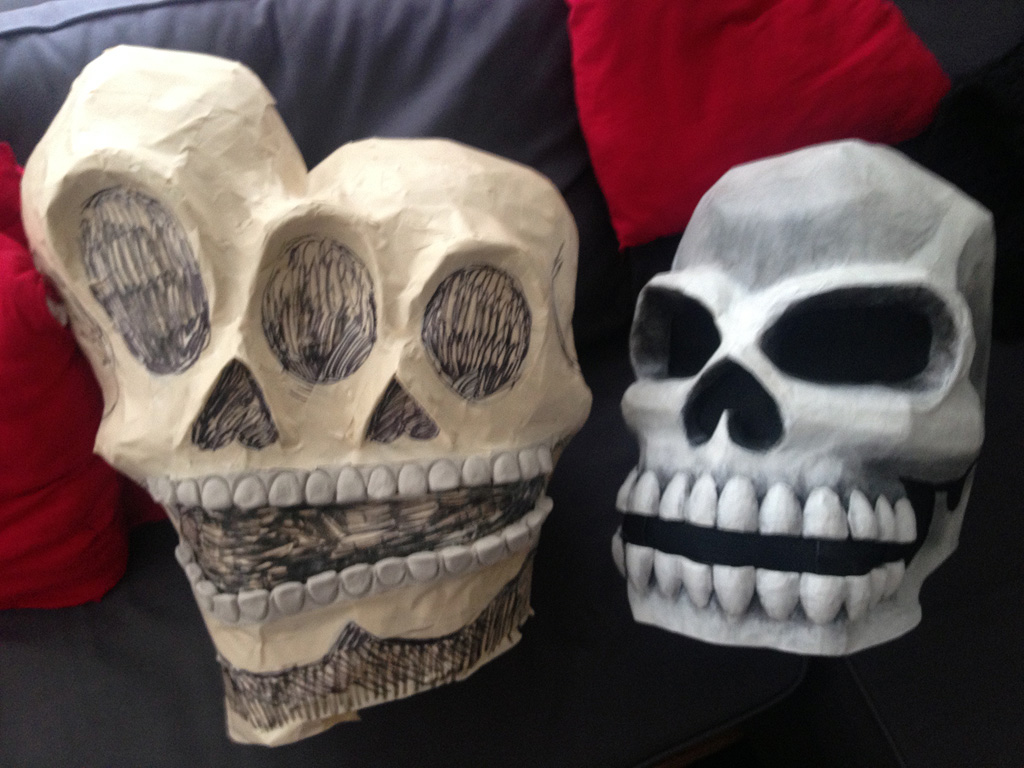 My conjoined twins skull in progress, with last year's skull mask for comparison