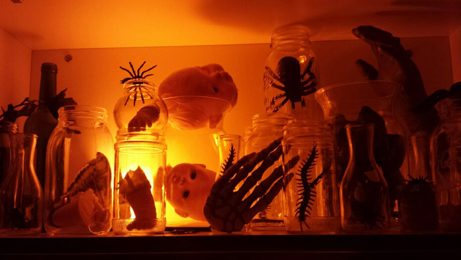 doll parts and bugs in jars simple halloween decoration