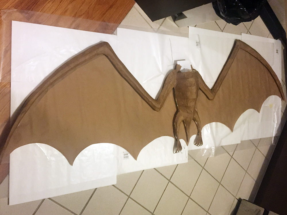 Papier mache bat -- cutting out the wings