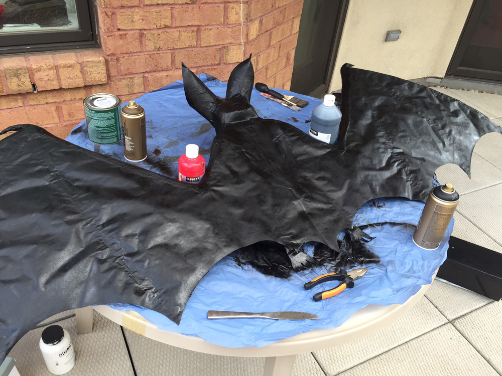 Papier maché bat -- black spray paint base coat