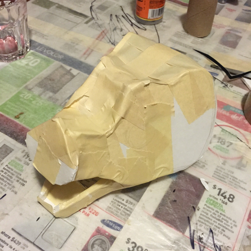 Papier mache bat -- adding tape to the skull