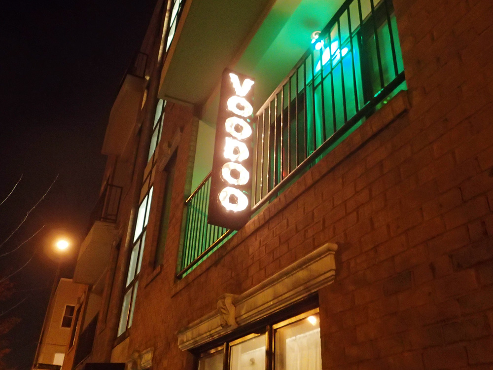 Light-up VOODOO sign on the balcony