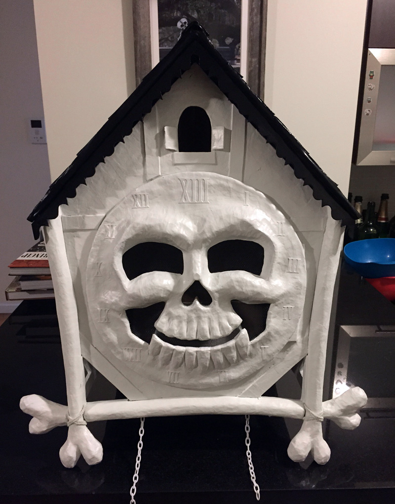 Cuckoo clock skull mask - roof and clock body spray painted!