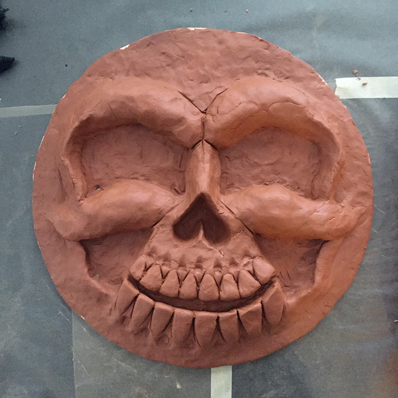 Cuckoo clock skull mask - sculpting the face with clay