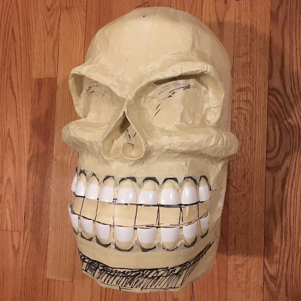 Twin paper mache skull masks - the finished base with teeth