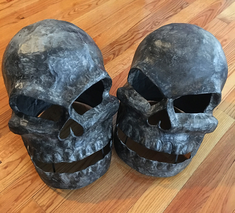 Twin paper mache skull masks - painting shadows