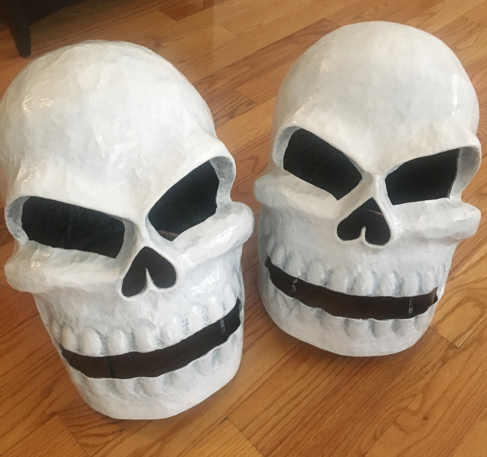 Twin paper mache skull masks - dry brushing