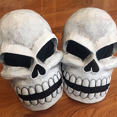 Paper mache twin skull masks by Manning Krull