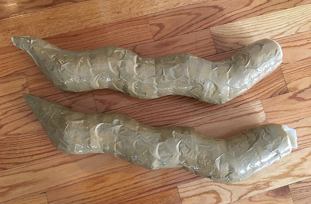 Papier maché dragon sculpture - packing tape to smooth out the body