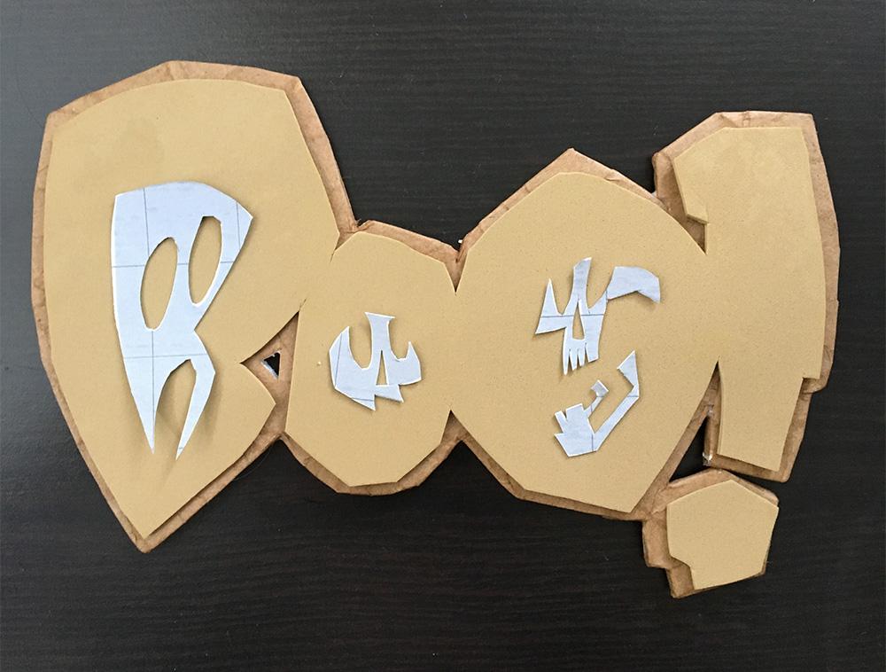 Haunted book sculpture - assembling the logo