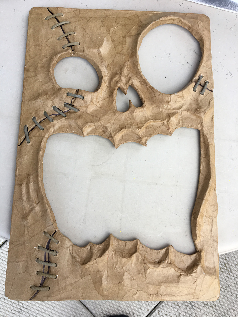 Haunted book sculpture - cutting out the face