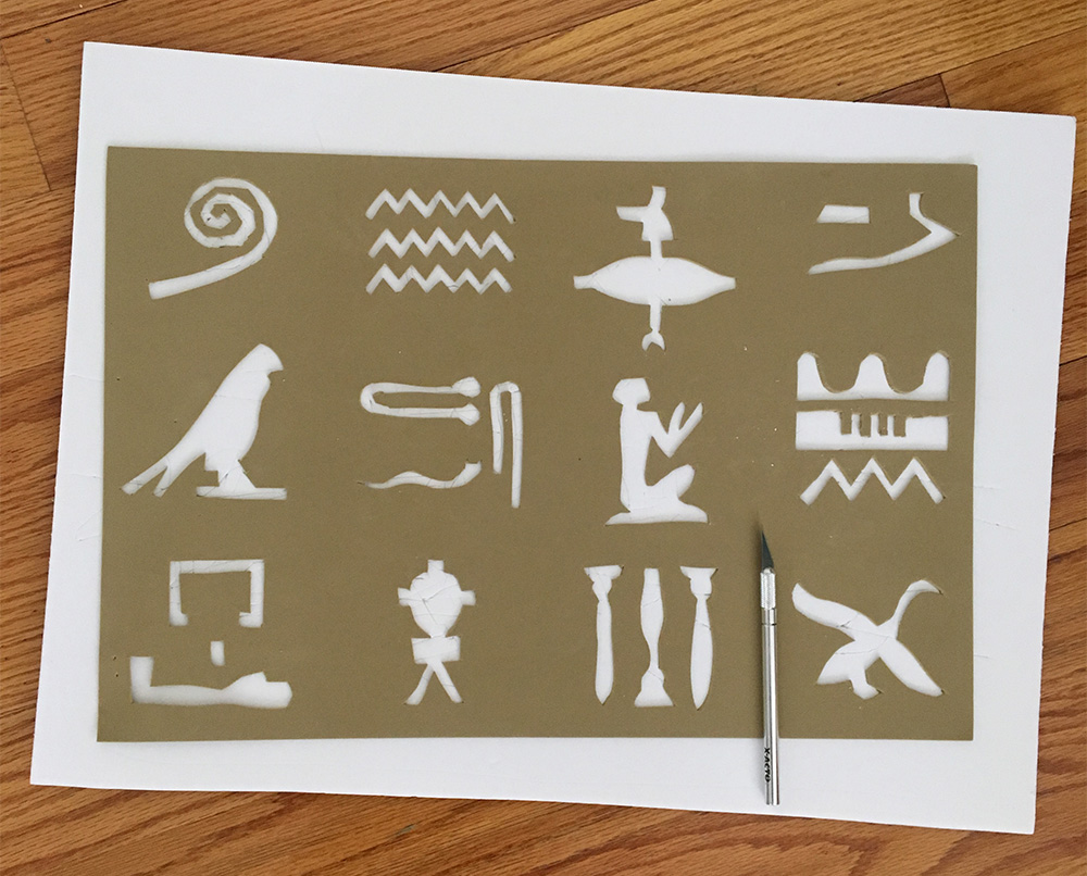 Egyptian hieroglyphs wall decoration - cutting out the stencil