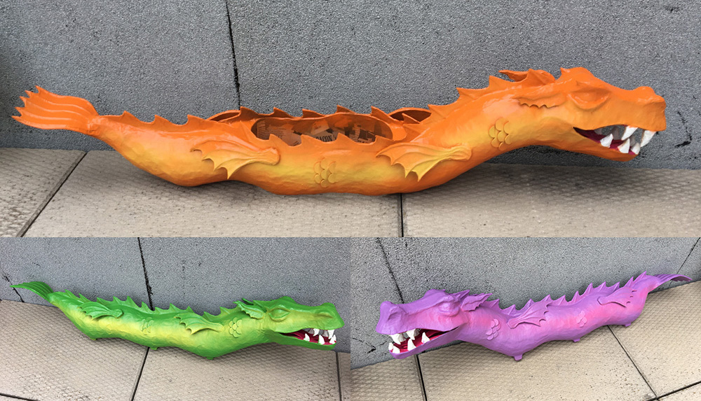 Paper mache three-headed dragon - spraypainting the bodies