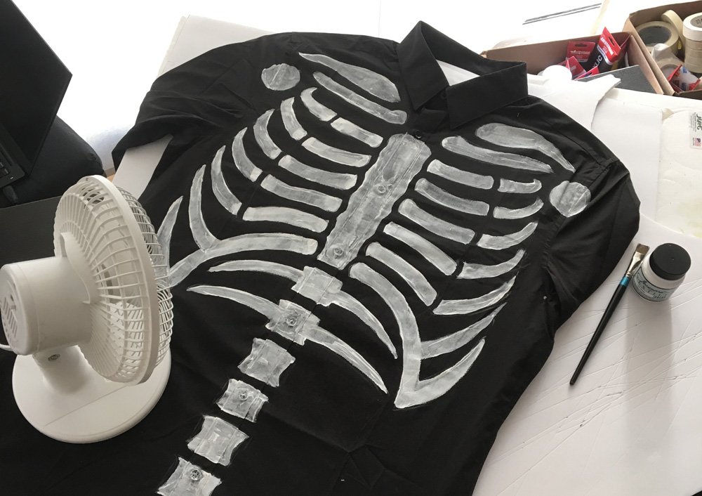 Painting a skeleton shirt with fabric paint