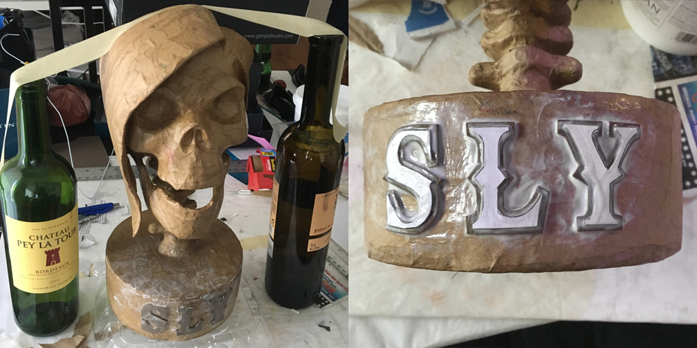 SLY skull sculpture - attaching the letters
