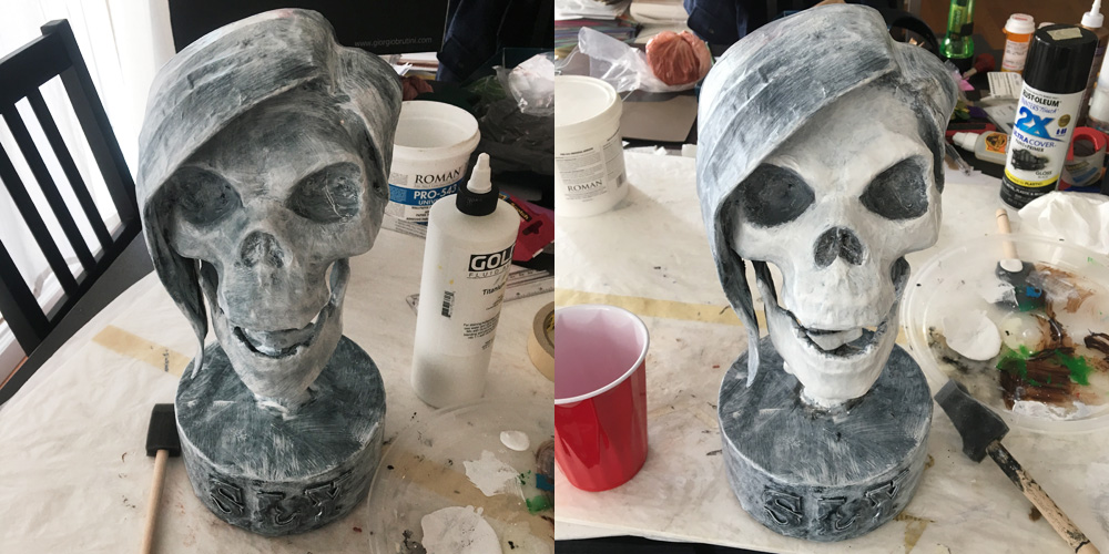 SLY skull sculpture - white acrylic paint