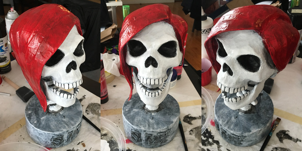 SLY skull sculpture - red acrylic for the hair