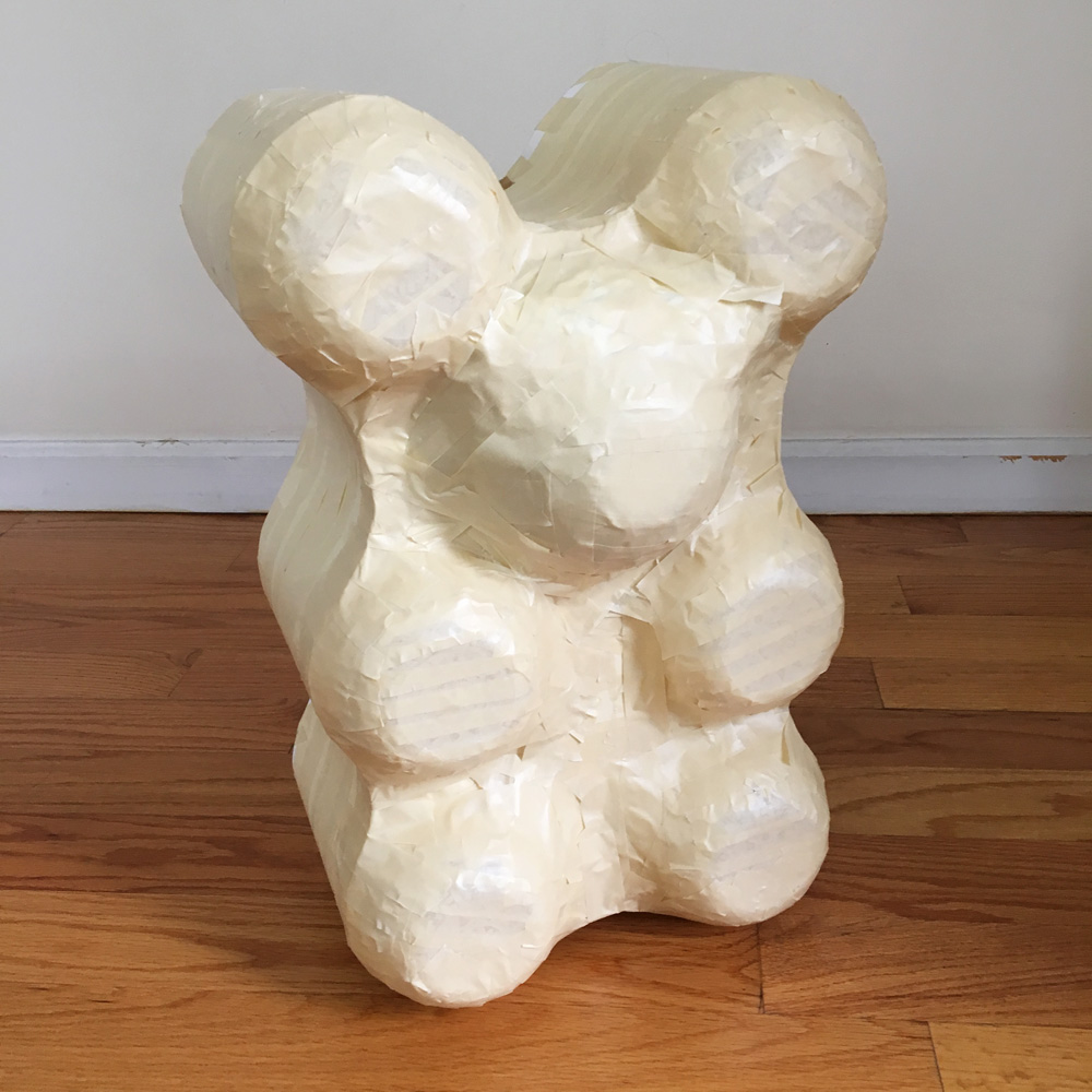 Giant paper mache gummi bears - adding a layer of masking tape