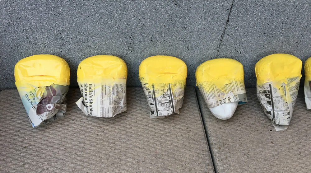 Giant candy corn decorations - yellow spray paint