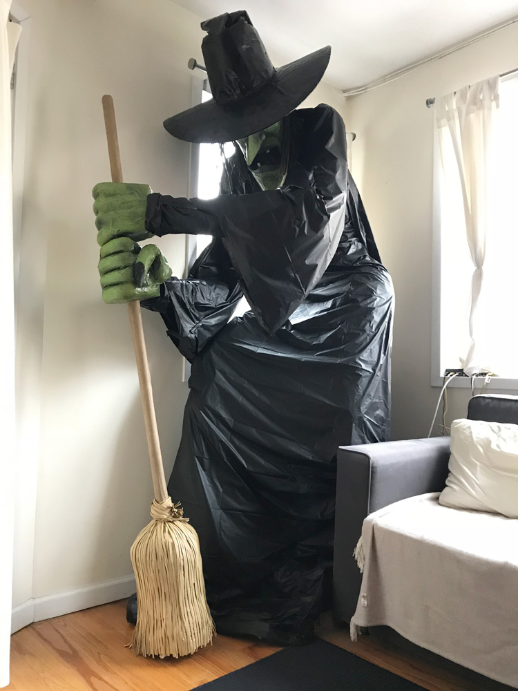 Giant witch statue made from paper mache, foam board, plastic table cloths, etc