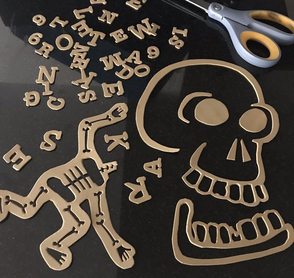 giant Skeleton Krewe doubloon - cutting out the foam shapes