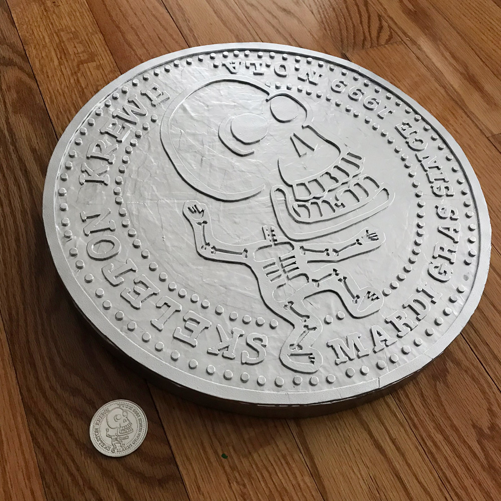 giant Skeleton Krewe doubloon - silver spray paint