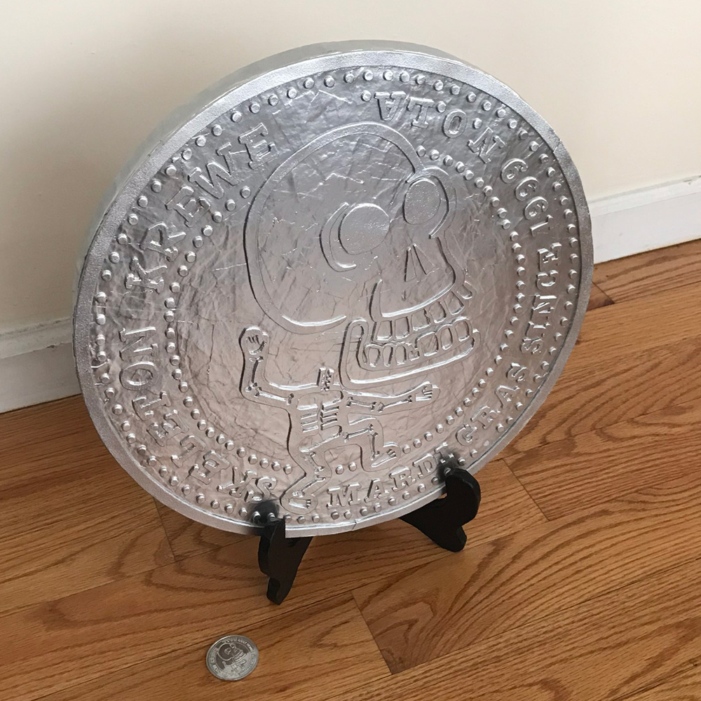 giant Skeleton Krewe doubloon - on stand