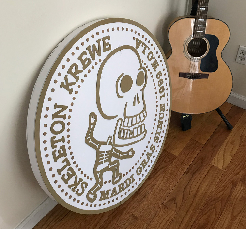 Giant 33-inch Skeleton Krewe doubloon - with guitar for scale
