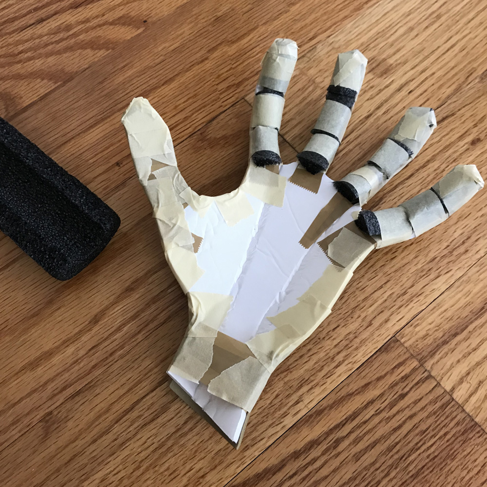 Paper mache Freddy Krueger hand prop - foam tubing to pad out the fingers