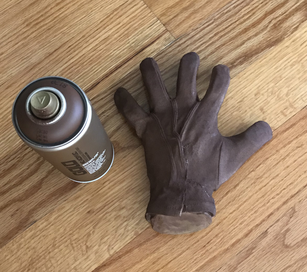 Paper mache Freddy Krueger hand prop - spray painting the glove