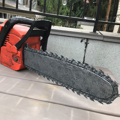 Paper mache chainsaw prop by Manning Krull