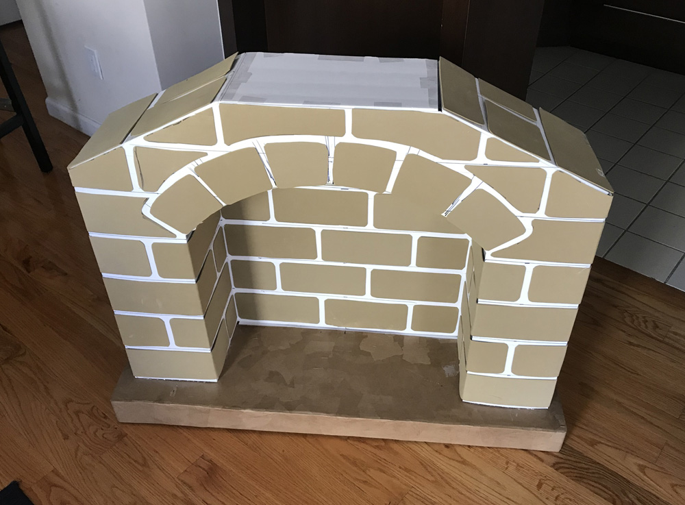 Paper mache fireplace prop - adding foam brick texture