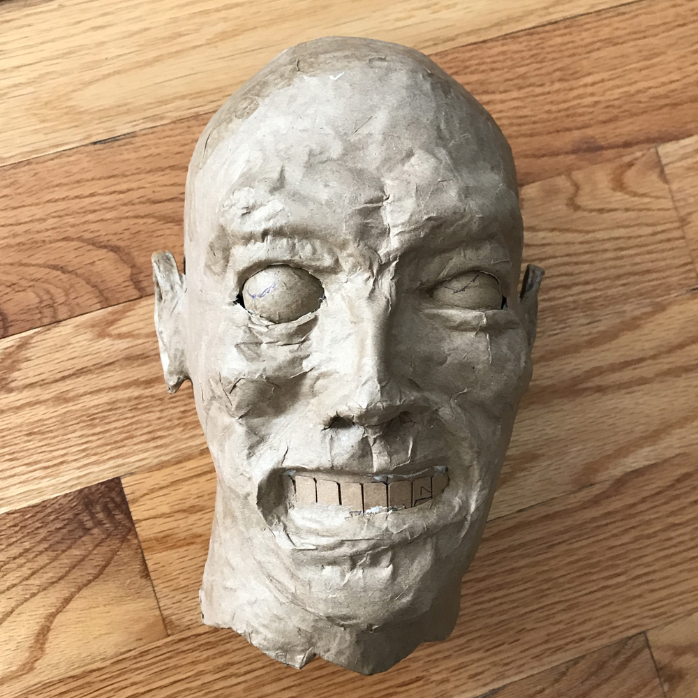 paper mache heads -- finishing the face