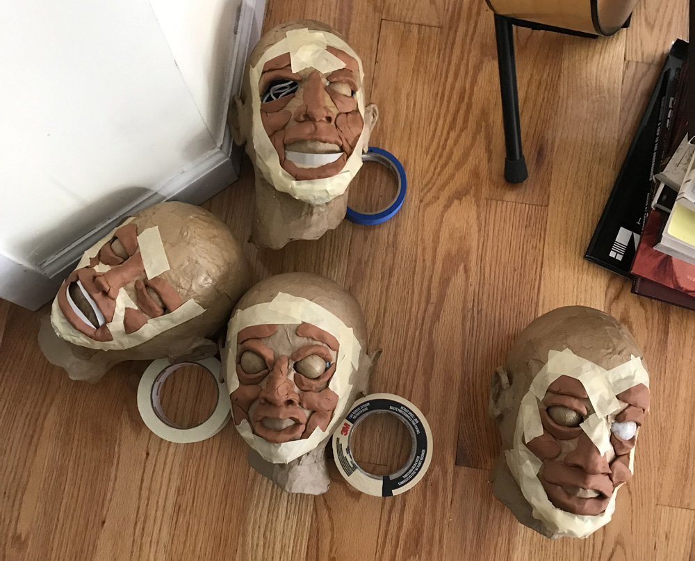paper mache heads -- sculpting faces with clay
