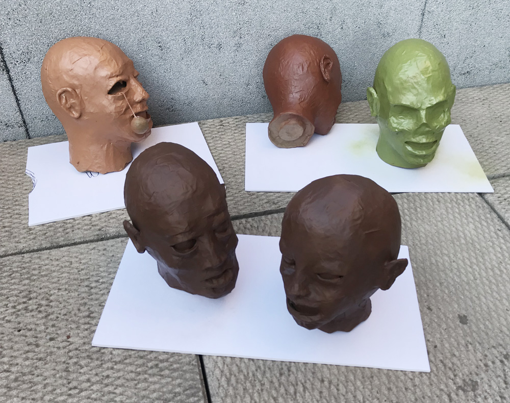 paper mache heads -- spray painting