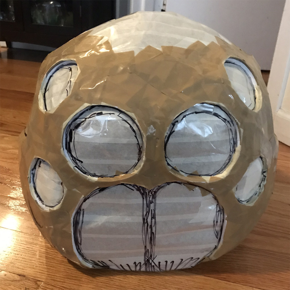 Paper maché spider skull mask -- shipping tape on face