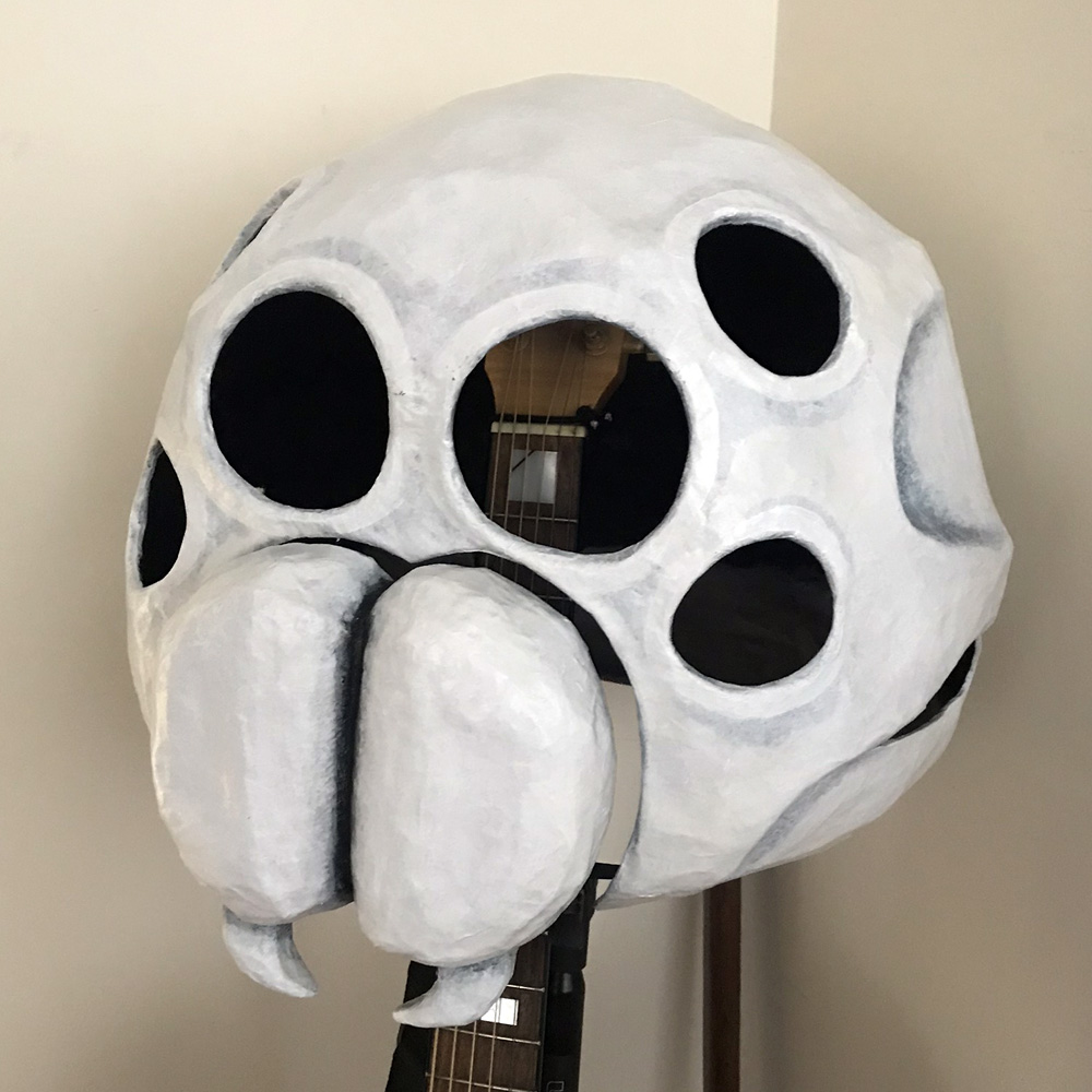 Paper maché spider skull mask - attaching the fangs