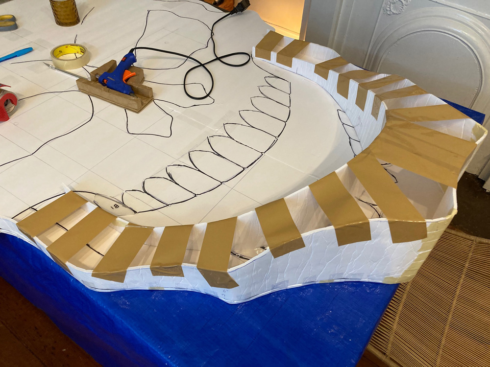 Giant paper maché skull Halloween decoration - building up facial structures