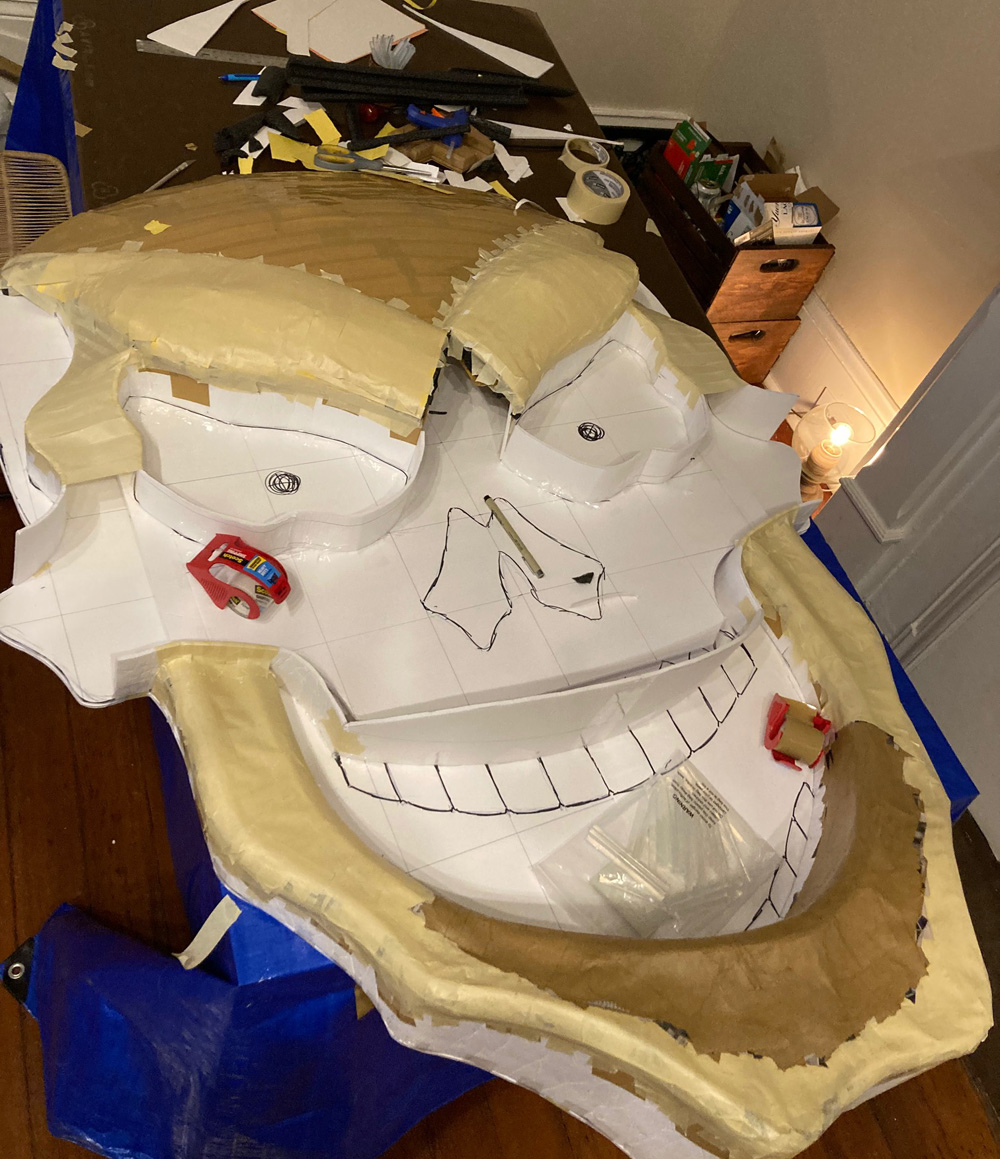 Giant paper maché skull Halloween decoration - sculpting the face