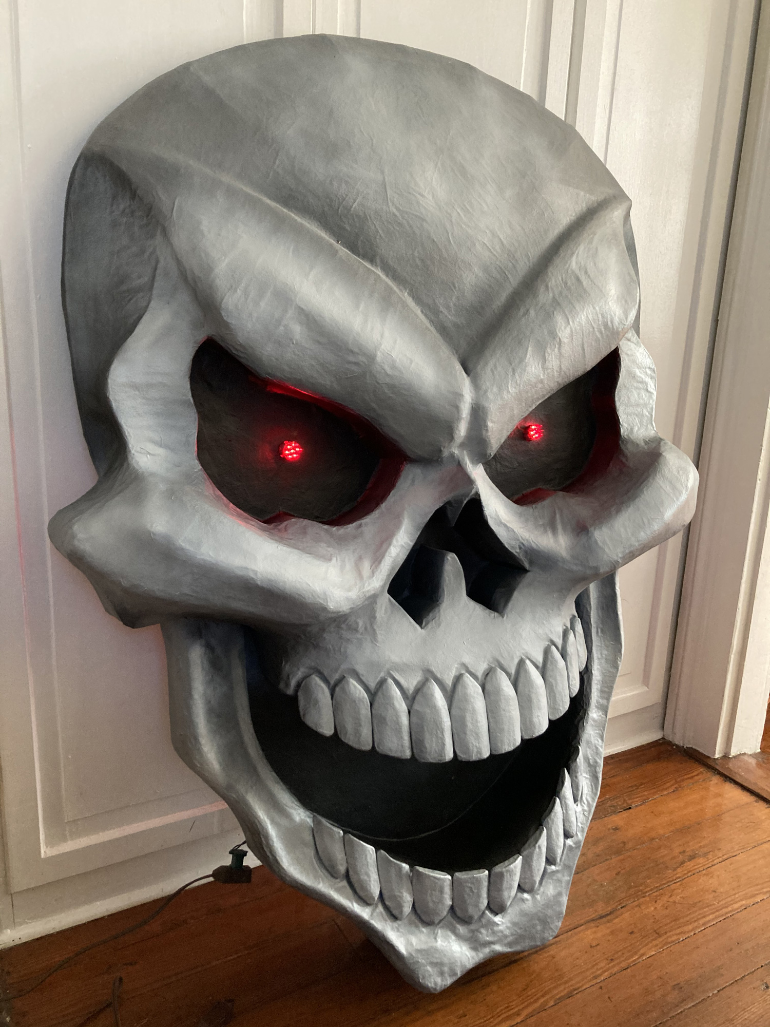 Giant paper maché skull Halloween decoration - side view