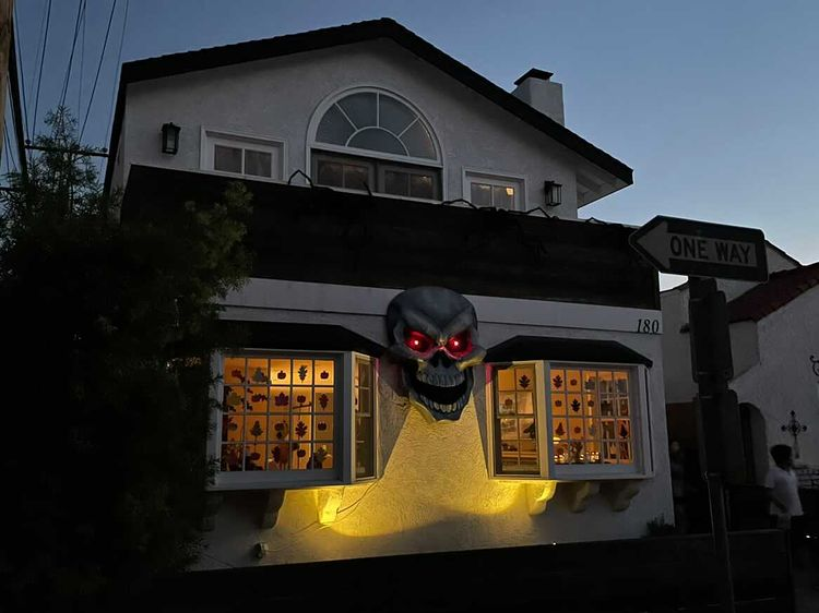 Giant paper maché skull Halloween decoration - night time view